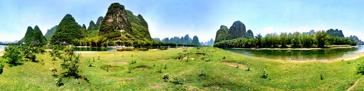 The scenery from Yangdi to Xingping is the most beautiful part of Li River, The peaks here rise like so many needles, while the rivers are like ribbons. Xingping River meanders from east to west into the Li River. The reflection of the trees, bamboos and peaks present a watercolor painting. Xingping, located by the Li River, is a time-honored ancient township.The town is really a beautiful place, surrounded by enthralling scenery. This pano i...