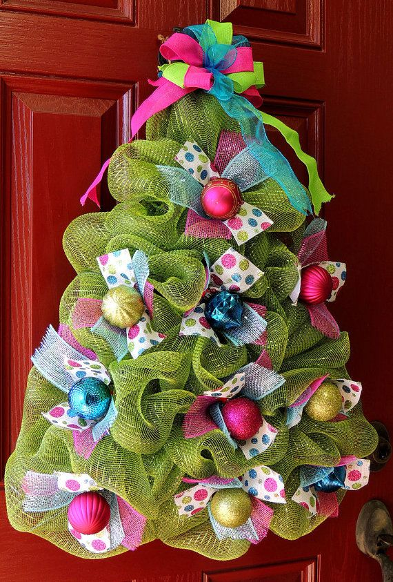 Beautiful and huge wreath will look amazing for your front door to hang on the wall, interior door or above your mantel. Deco mesh Christmas tree wreath. Included in this wreath is Moss Lime green deco mesh, premium metallic Turquoise Blue and Pink mesh, 4 types of high quality
