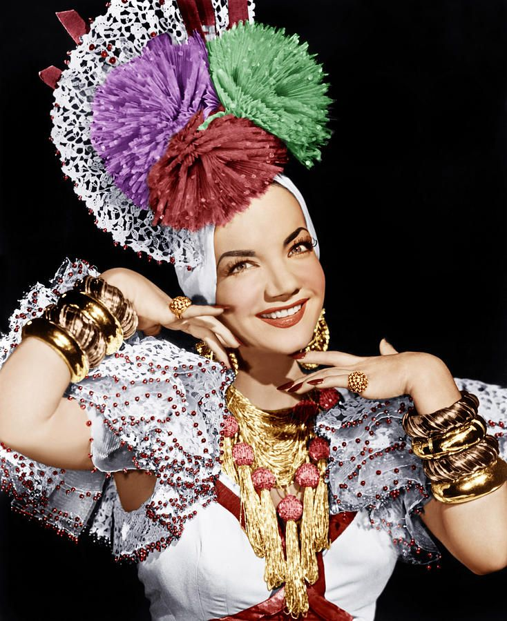 "Carmen Miranda, 1909-1955 Was a Portuguese Born Brazilian, samba singer, broardway & Hollywood actress & film star in the 40's, 50's. Was known as ""The Brazilian Bombshell"" she was by far one of the highest earning actresses in America. Her signature Fruit hat and outfit she designed herself. She was a very talented dancer and actress."