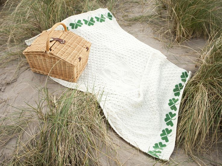 "Traditional Knitting for all to see. This wool Blanket is very special. Made from 100% Merino wool it easy to see how perfect it is for cuddling up with, and it is a must for the cold winter evenings ahead. The Blanket is 40"" X 58"" and it is kitted using the Irish Cable stitching and is said to resemble the fisherman's ropes and brings hopes of a fruitful day at Sea.  The traditional green shamrock pattern along the bottom is sure to bring 'the luck of the Irish' to the owner. Perfect for…"