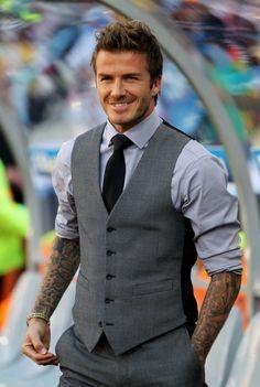 David Beckham stylin' a slate gray vest and slacks with black tie <3