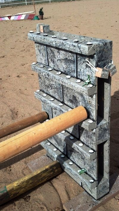 How to make your own horse jumps. This page has photos of different types of standards, flower boxes, and poles. I especially like the jump block made from a pallet.