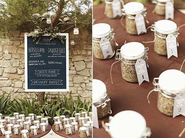 Home made jars of herbs served as both escort cards and favors.