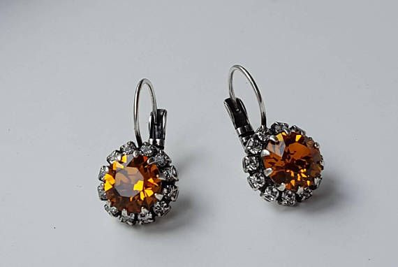 Check out this item in my Etsy shop https://www.etsy.com/ca/listing/550188037/topaz-crystal-gold-drop-earring-yellow