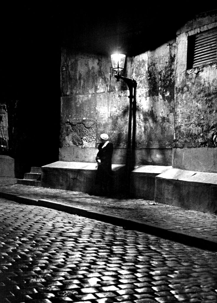 onlyoldphotography:  Alfred Eisenstaedt: Woman under streetlight in Montmartre at night. Paris, France, 1963