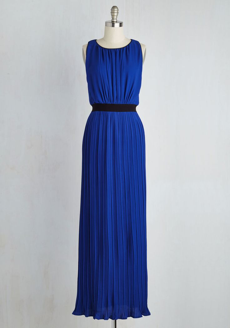 By draping yourself in this cobalt gown, embracing your inner socialite is a snap! Your confidence sparkles while clad in the elongated back keyhole, black defined waist, and flowing pleated skirt of this magnificent maxi, making you look - and feel - like the 'it' gal of the gala.