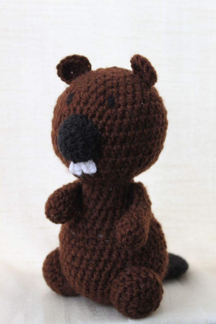 Dave the beaver. Amigurumi plush animal. The animal is approximately 20 cm tall.