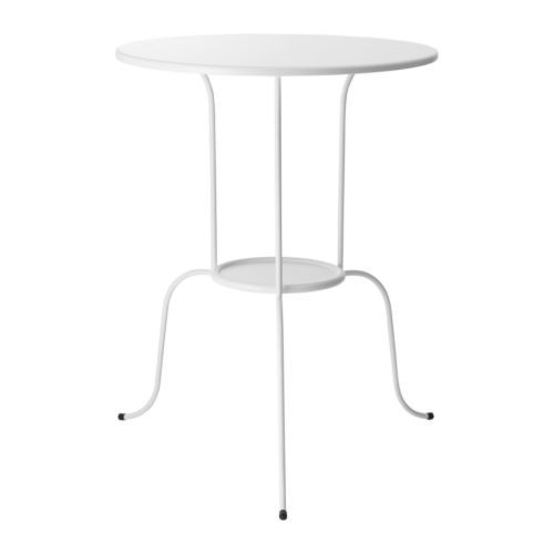 $19.99 Ikea Lindved side table in white - she can pick a table cover or leave plain or put a mat on top...simple, inexpensive and EASY TO KEEP CLEAN