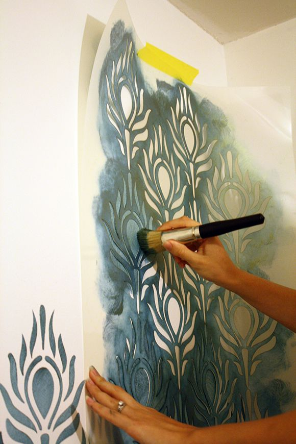 How to stencil: large peacock stencil in teal paint  I'd love to do something like this in our laundry room/pantry