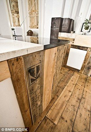 Food for thought: Wooden pallets have also been used to make the kitchen cupboards. The couple say the kitchen is where they saved the most cash