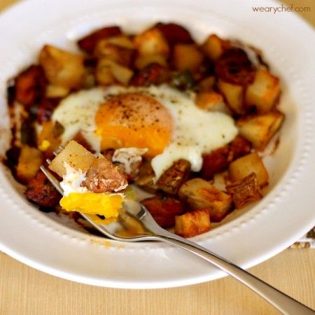 Baked Egg over Roasted Potatoes and Sausage - The Weary Chef