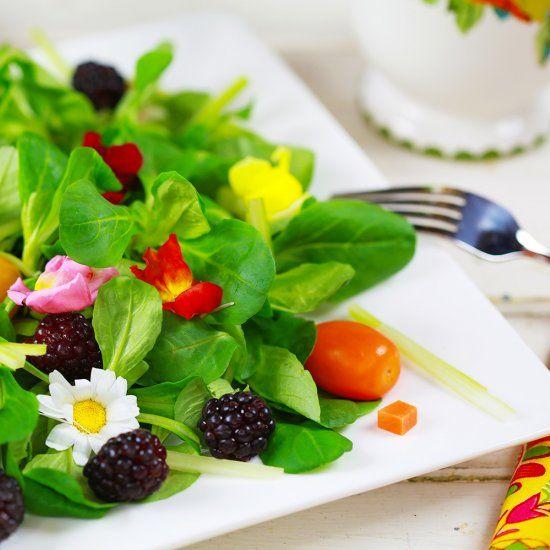 Delicate, nutty-flavored mache lettuce pairs with fresh juicy sweet blackberries, edible flowers & more to make this vegan salad.