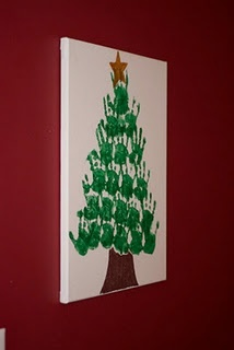 hand print Christmas tree! I kinda want to do this, and make it a yearly decoration for our house.