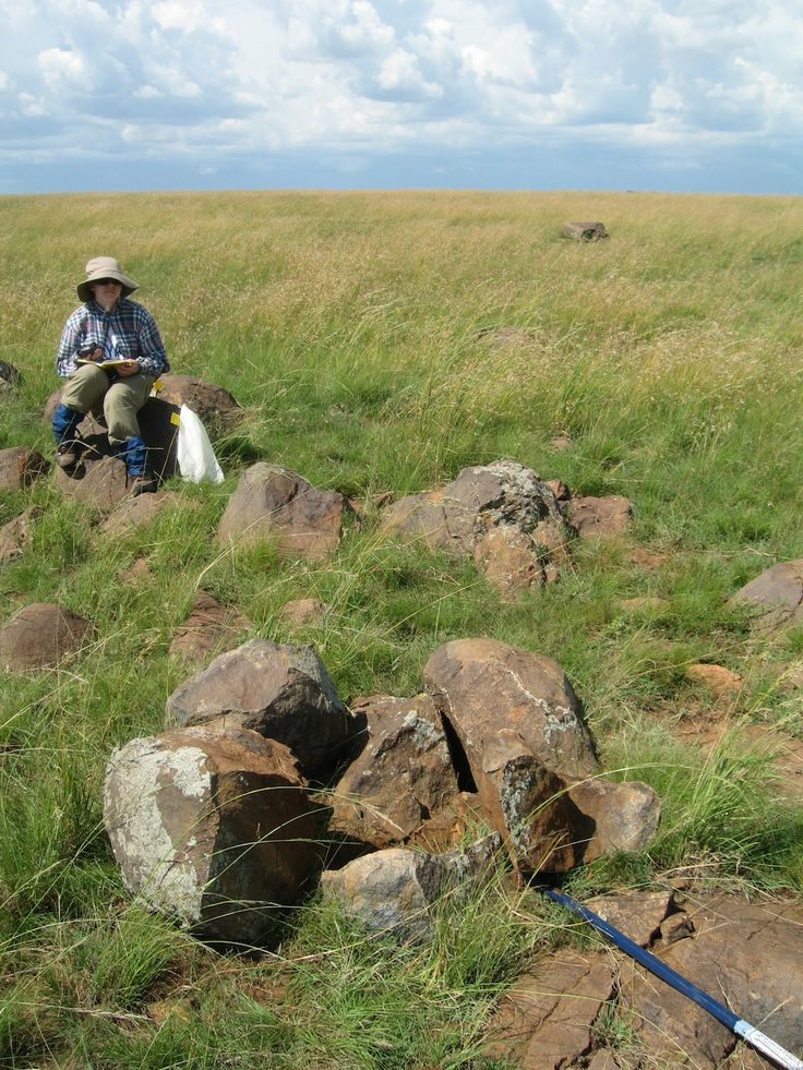 Lisa Cupelli at an outcrop of gabbronorite at the Vredefort impact crater.