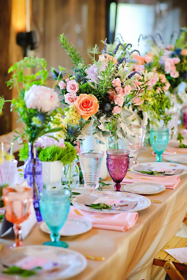 Eek! Look at how cute our gold flatware, mismatched china, and pink, purple, and teal goblets look here! Love!!!