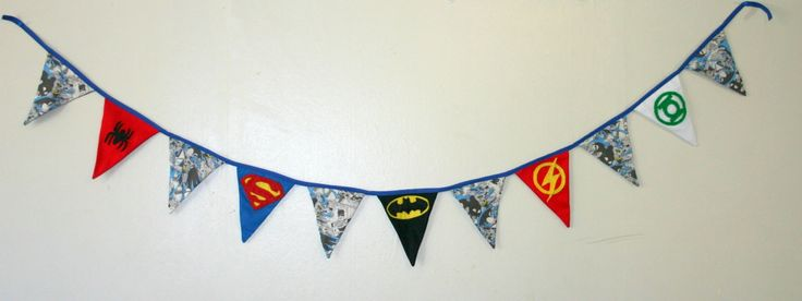 This gorgeous Super Hero Bunting will look gorgeous in any child's bedroom or your ,'man childs' man cave.  Super Hero Logos will remain the same unless otherwise discussed. The patterned fabric between logo flags is subject to change depending on availability.
