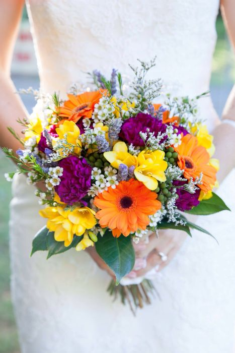 A Summer Bouquet with a gorgeous mix of vibrant blooms. Photo Source: Lisa Diederich #weddingflowers #summerbouquets