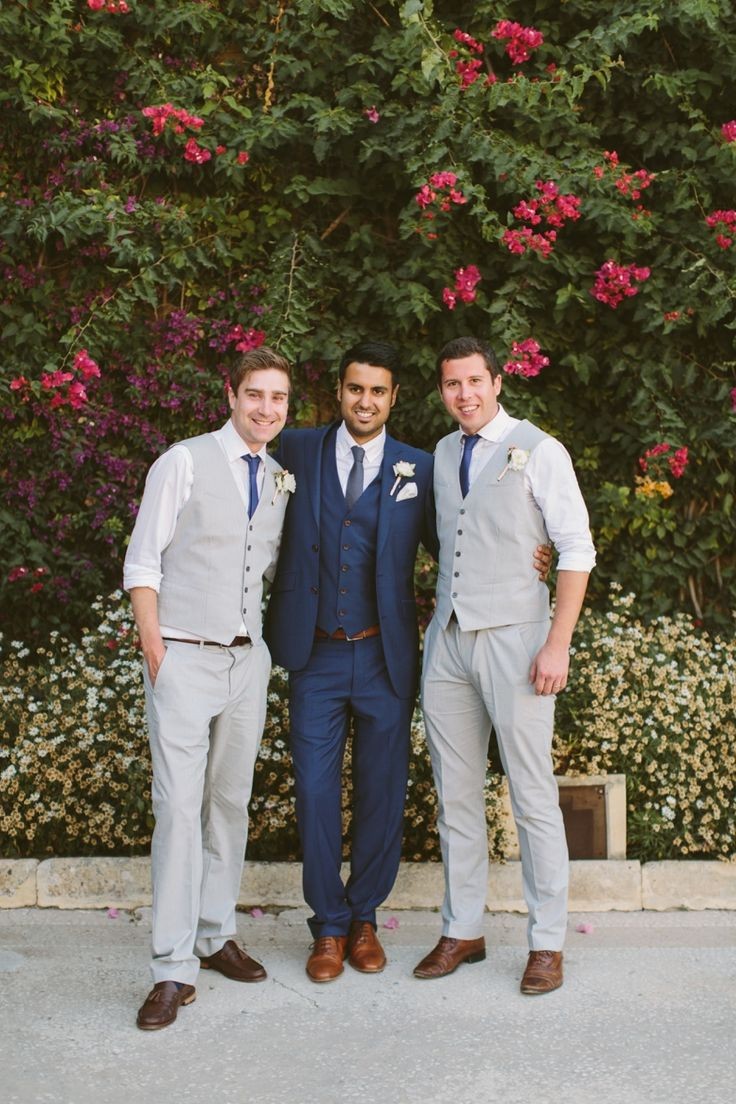 Groom in Navy, Groomsmen in Grey More