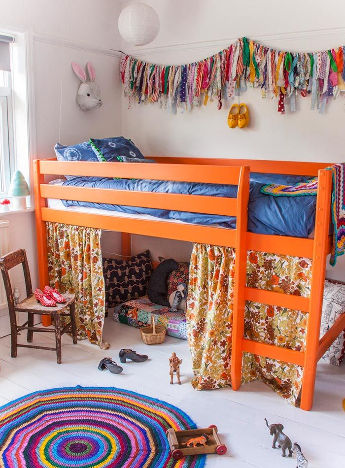 orange loft bed, rainbow fabric garland :: An English Home Where White Paint Allows Colors to Pop | Design*Sponge