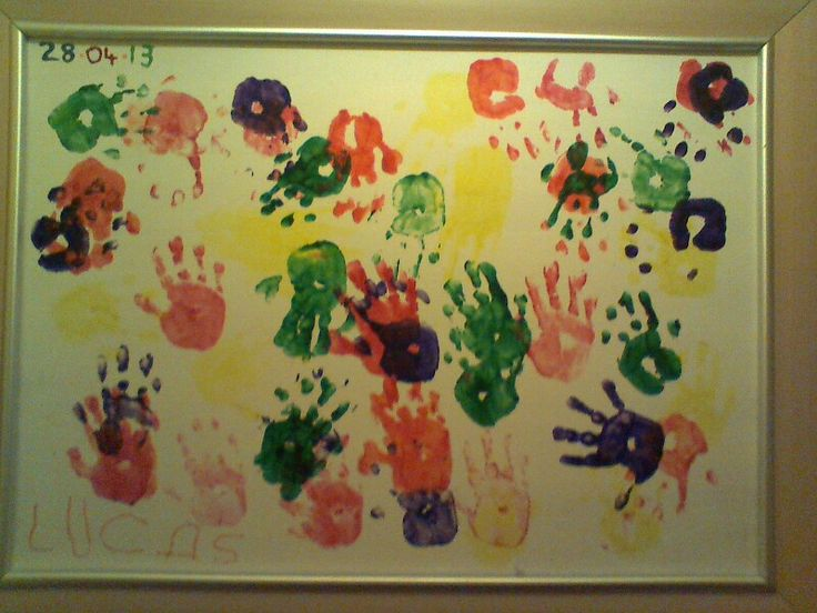 Colourful handprint picture made from a broken mirror frame. After my mirror fell off the wall i decided to spruce it up a little, painted the back with some matt white paint i had in the shed and got my son to do some multicoloured handprints and sign it, it now hangs where everyone can see as they enter my house and gets compliments by everybody and even better is that it didn't cost a thing, priceless memory... Literally! :-)