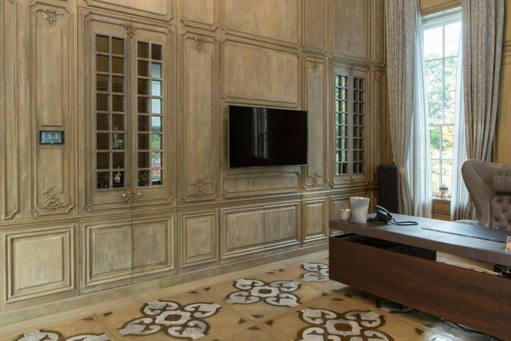 Boiserie Aron: Artistic wood boiserie of Classic Progènie collection, with marble inlays, wood, metal, and other materials.