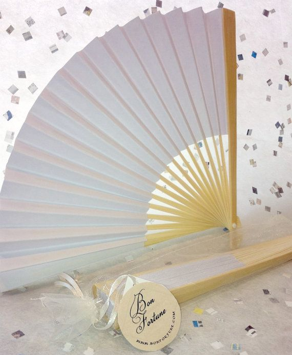 Homemade paper fans are a great, inexpensive way to help guests stay cool on warm summer evenings. Made by BonFortune.
