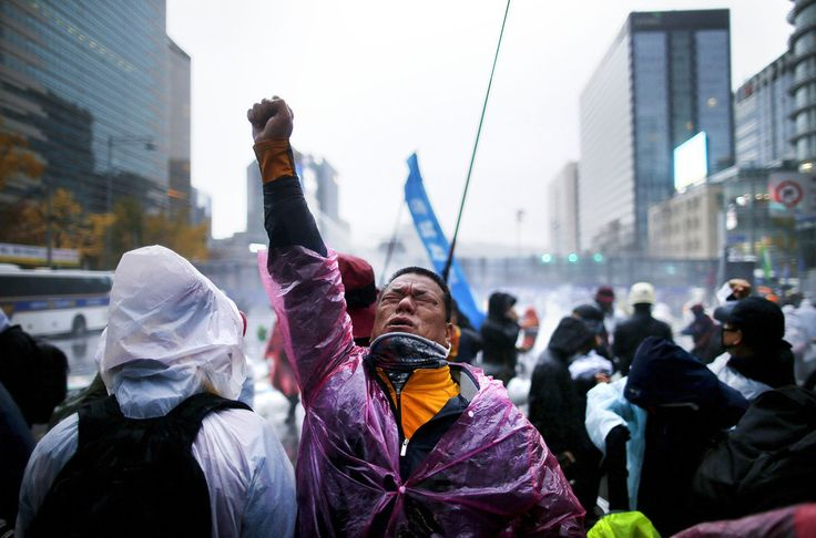 A protester reacts as water mixed with #teargas is sprayed by a #policewatercanon to disperse #protesters, during an anti-government rally in central #Seoul, #SouthKorea. Tens of thousands protested against South Korean President #ParkGeunhye's #labour and #education policies on Saturday in one of the largest street rallies in recent years.