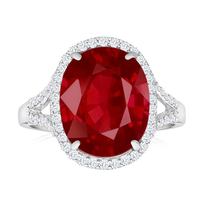 Unique cocktail ring with large Natural Enhanced Ruby with a Diamond halo in 18ct Gold. Stunning!