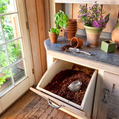 Open shelves beneath awning windows keep herbs happy when the weather turns chilly, and a handy tip-out bin keeps potting soil at the ready.