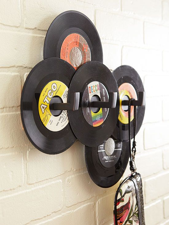 Records  Strike a high note in an entry by accenting a store-bought three-hook coatrack with old records. Arrange colorful vinyl 45s, which you can score for as little as 50 cents secondhand, around the hooks. Glue the records to the rack and to one another with a heavy-duty adhesive.