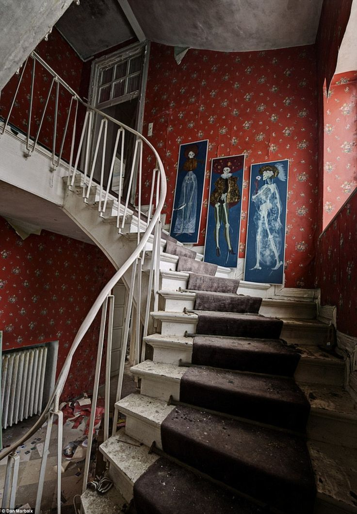 Three spectres: These eerie skeletal images guide visitors up the stairway to the house's second floor. Abandoned doctor's house, Germany.