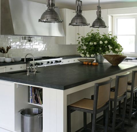 Amazing kitchen design with white kitchen cabinets & kitchen island, soapstone counter tops, Hudson Valley Naugatuck Large Pendants, pot filler and glossy white subway tiles backsplash.