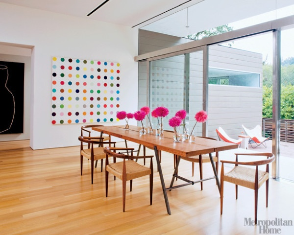 the dot painting is by Damien Hirst.