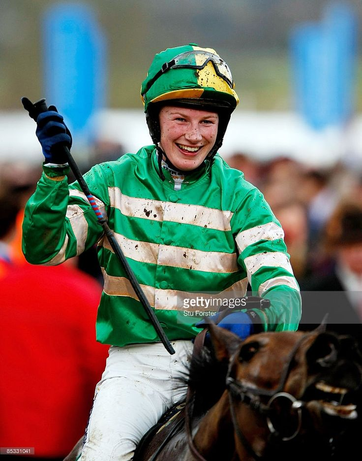 Jockey Nina Carberry celebrates after riding Garde Champetre to victory in the Glenfarclas handicap steeple chase during day one of the Cheltenham Festival at Cheltenham racecourse on March 10, 2009 in Cheltenham, England.