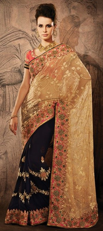Beige + Black = Awesome #colorblock. Get this #saree style here. #Partywear