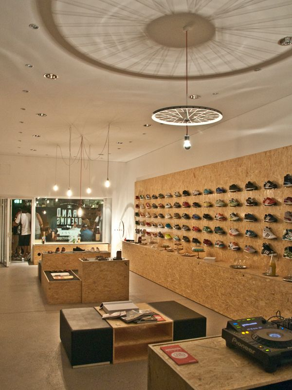For the Stuttgart based Suppa Sneaker Boutique, STUDIO DLF came up with a retail concept which puts the focus on the sneaker itself, presenting it in a modern and minimalist atmosphere. Year: 2012 Scope: Concept, Design, Planning, Setup Materials: OSB, Rim Lamp series, tar mats studio-dlf.com