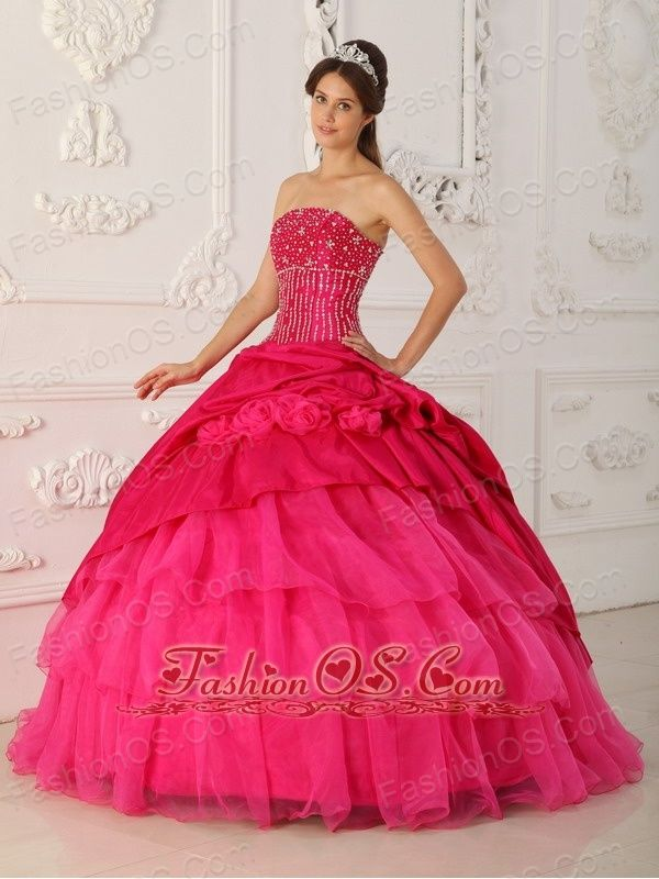 Lovely Hot Pink Quinceanera Dress Strapless Organza and Taffeta Beading Ball Gown  http://www.fashionos.com  The hot pink strapless beaded ruffles floor length quinceanera gown is your perfect choice to attend ball, wedding and party. Fitting bodice design with beaded decoration makes the gown so beautiful and sexy that you can gain more attention and no matter what you attend, you will become the spotlight. Besides, the tulle pleating design like the lotus leaves.