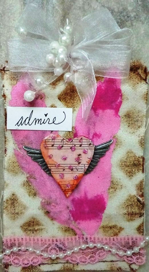 For this tag I used a Clear Scraps feather as a stencil with adding paint and pressing on the canvas tag. For the background I used ink and a Mascil from Clear Scraps.
