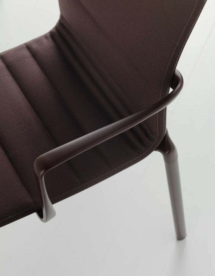 a detail of bigframe chair with Kvadrat fabric