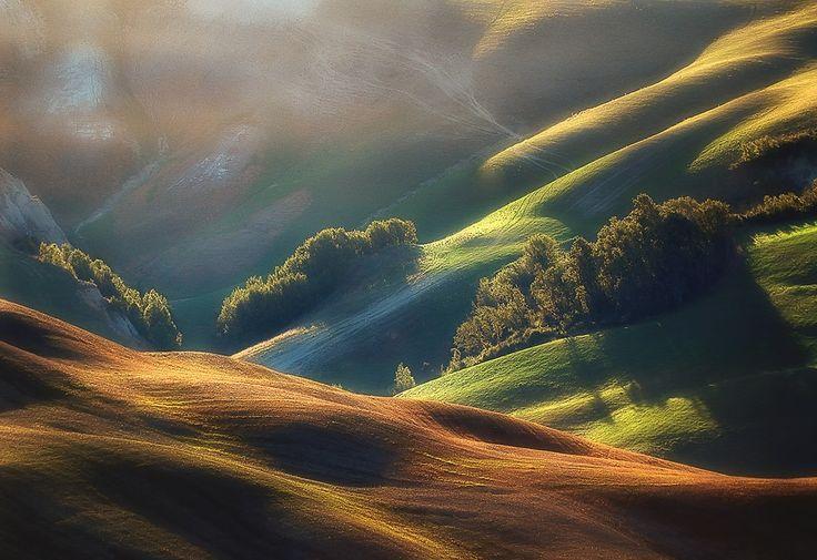 Beautiful! I always enjoy landscape photos like this, taken in the early morning - Tuscany Sunrise by Jarek Pawlak