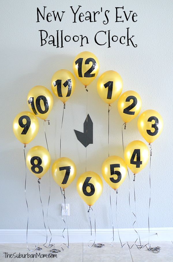 Make a fun and interactive New Year's Eve Balloon Clock for the kids to take down this New Year's Eve!
