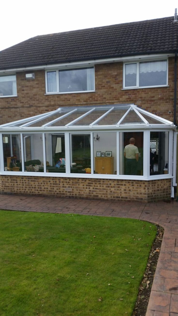 Odd Front Victorian Conservatory in white with a rated glass as standard including Satin Silver hardware. Installed in Edwinstowe, Nottingham. For a free quotation call us on 01158 660066 visit our website http://www.thenottinghamwindowcompany.co.uk or pop into our West Bridgford showroom.