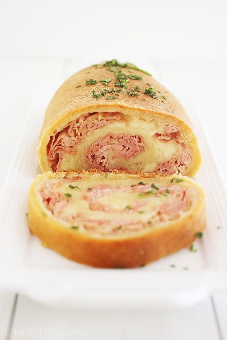 3-Ingredient Baked Ham and Cheese Rollups – These scrumptious ham and cheese rollups are easily made with pizza dough for a delish weeknight meal!   thecomfortofcooking.com