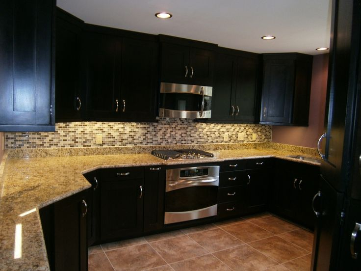 trendy hand crafted espresso cabinets stained as well as mosaic backsplash and lighting kitchen decors in wide kitchen designs - Kitchen Backsplash With Dark Cabinets