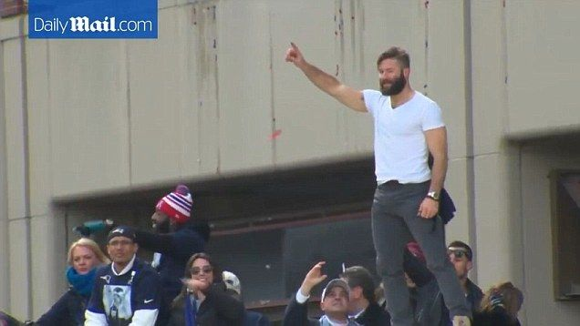 Julian Edelman acknowledges cheers from the crowd gathered for the New England Patriot's Superbowl parade on Wednesday.