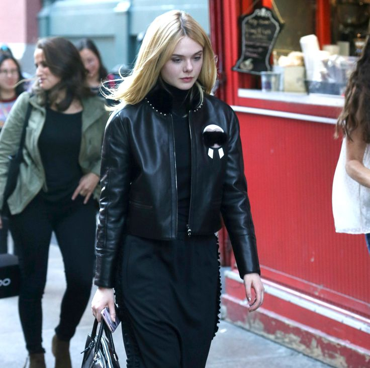Elle Fanning stands out amongst the crowds of NYC in an Fendi Karlito black leather jacket.