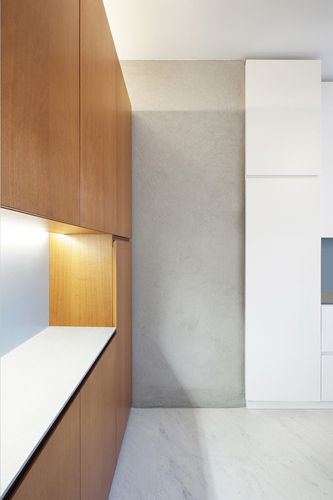 Appartamento/ 019 / Anna Angelelli, Antonio Bergamasco, Michela Cicuto timber veneer / fibre cement sheet / concealed uplighting to top of joinery
