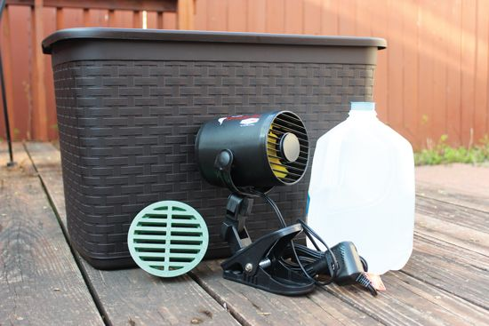 Make a homemade air conditioner using a small fan, a plastic tote, and some frozen jugs of water.