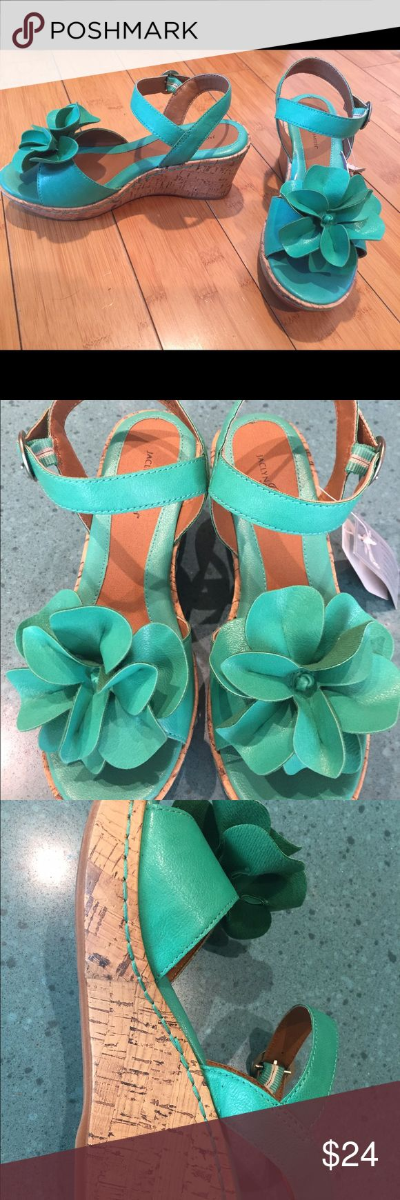 NEW green wedge high heeled sandal NEW!!! Gorgeous green wedged corked heel shoe with whimsical flower -perfect for soon to bloom springtime! Women's shoe size 6.5. Don't let this one get away at a great price! Jacyln Smith Shoes Heels