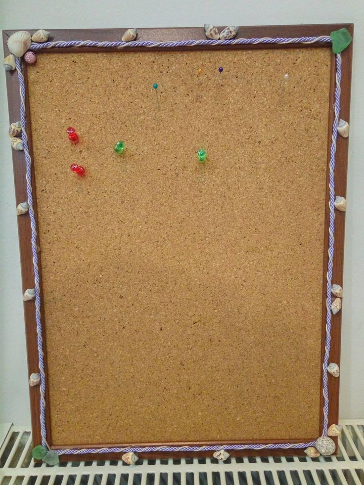 Pinboard decorated with shells and sea glass